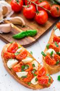 Bruschetta with cherry tomato and mozzarella - stock photo