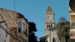 Spain Mallorca Island small town Porto Cristo 029 Spanish church and blue sky Stock Footage