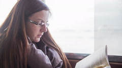 Woman read book on ship Stock Footage