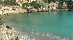 Spain Mallorca Island small town Porto Cristo 023 turquoise water on rocky shore Stock Footage