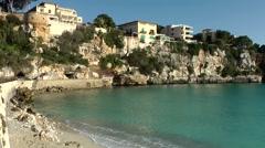 Spain Mallorca Island small town Porto Cristo 022 rough shore of  city center Stock Footage