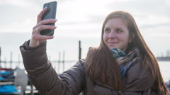 Girl takes a selfie and sends to friends Stock Footage