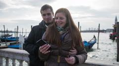 Romantic couple take selfie with gondolas in Venice Stock Footage