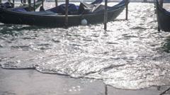 Sea splashing in harbor in Venice Stock Footage