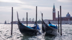 Two gondolas in sea with tower in background Stock Footage