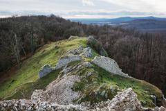 Ruins of the castle Hrusov in deciduous forest and surrounding countryside Stock Photos