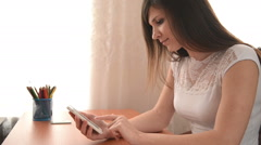 Young woman use a smartphone - stock footage