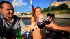 Group Of Happy Young Friends Enjoying Dinner Outdoor in ship cruise. HD Stock Footage