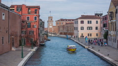 Taxi boat in Venice water canal Stock Footage