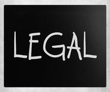 """The word """"Legal"""" handwritten with white chalk on a blackboard Stock Photos"""