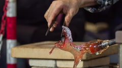 Horse sculpture from glass taking shape close up Stock Footage