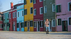 Woman sightseeing Burano town Stock Footage