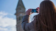 Taking picture of famous Burano church Stock Footage