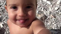 Filming a hyperactive baby close up Stock Footage