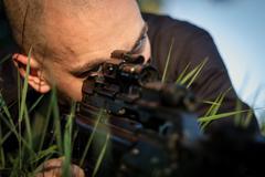 Portrait of a sniper man in combat - stock photo