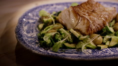 Healthy dish, grilled cod with vegetables and pine nuts Stock Footage