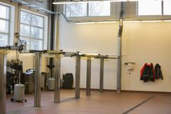 Empty hoists at automobile repair shop Stock Photos