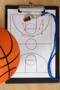 Close-up Of Basketball With Whistle And Sport Tactics On Paper Stock Photos