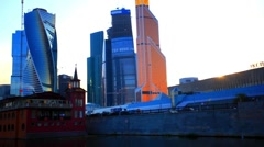 Tour  across river Moscow in sunset time, Russia. View on international business Stock Footage