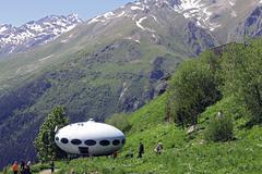 Stock Photo of People around UFO that landing between caucasus mountains