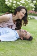 Playful young couple having leisure time in park - stock photo