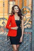 Girl in a red jacket with scarlet lips. Stock Photos