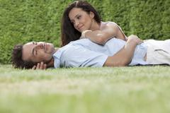 Stock Photo of Loving young couple spending quality time in park