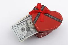 Love gift with US Dollars (USD). Stock Photos