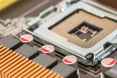 CPU Socket And Capacitors On Motherboard Stock Photos
