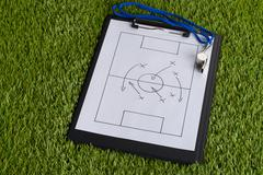 Whistle And Clipboard With Soccer Tactic Diagram On Green Pitch Kuvituskuvat