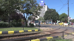 Bus stop station, tram streetcar station refuge, commuting area, weekend traffic Stock Footage