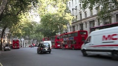 Red London Buses in Aldywch, City of Westminster, Central London, UK Stock Footage