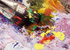 Art still life - two paintbrushes and dirty palette with colourful  paints Stock Photos