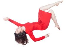 Woman in red dress falls. Stock Photos