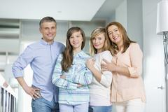 Portrait of happy family with children standing together at home Stock Photos