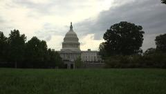 Dolly shot from behind a lamp post reveals US Capitol Building in Washington, DC Stock Footage