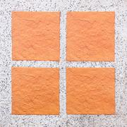 An Arrangement of four tiles on pebble background Stock Photos