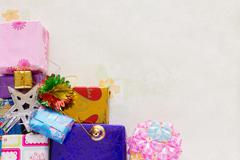 A stacking and decoration of present of holiday gifts over background - stock photo