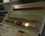 Stock Video Footage of 1980s sound editor at work on a 24 tracks audio remote control