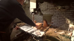 Clog maker sawing wood with a band saw [Slomo] - stock footage