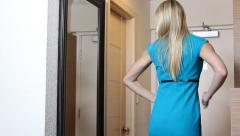 Businesswoman getting ready in mirror for work Stock Footage