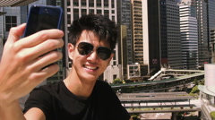 Man taking selfie with mobile phone Stock Footage