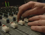 Stock Video Footage of 1980s music mix table in recording studio multitrack, slider down