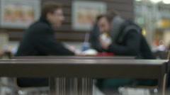 Two men eat fastfood - stock footage