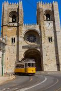 Cathedral with yellow tram, Lisbon, Portugal Stock Photos
