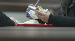 Man eats hamburger the other waits - stock footage