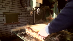 Clog maker sawing wood with a band saw [Slomo] Stock Footage