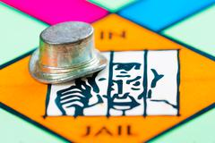Hat token next to the JAIL in a Monopoly game Stock Photos