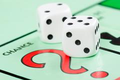 Dice next to the CHANCE space in a Monopoly game Stock Photos