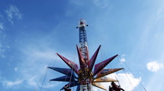 The chains carousel and blue sky Stock Footage